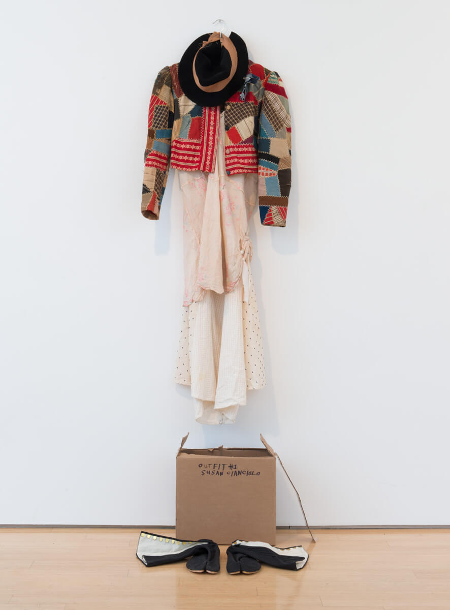 Susan Cianciolo                                         'Outfit #1 from Queens and Kings and Working Class Heroes', 2015                                          75 x 24 x 22 Inches                                          quilted cloth jacket, cotton dress, hat, cardboard box, shoes